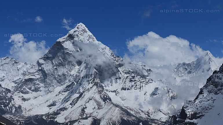 Peak of Ama Dablam surrounded by clouds