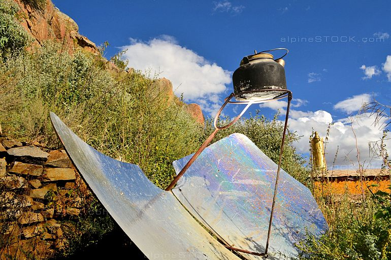tea kettle boiling by solar parabolic reflector