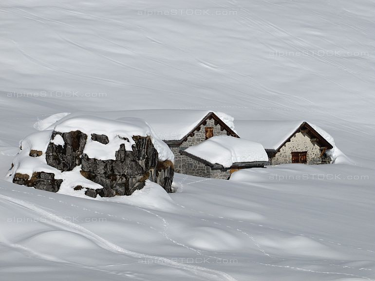 Huts and rock in the snow