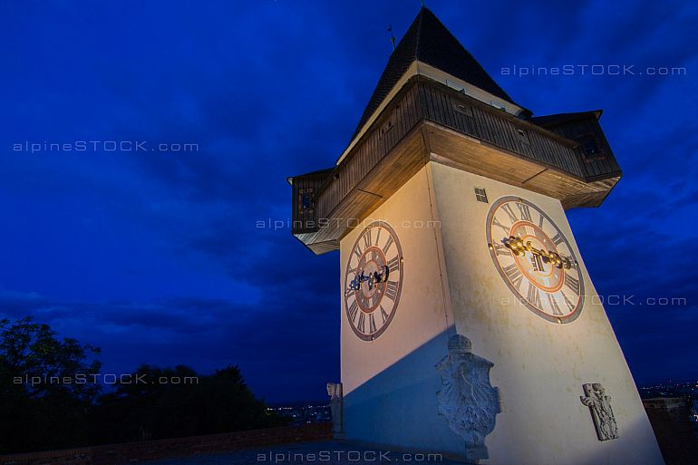 The clock tower of Graz Austria illuminated