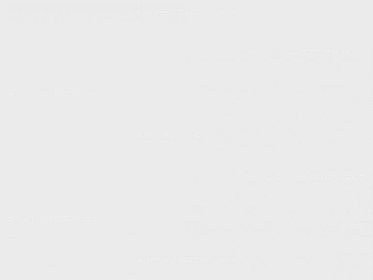 cows grazing in a spring country landscape with a lake and mountains in the background