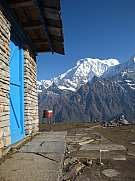 House with blue painted door and Annapurna South