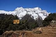 Scene in the Everest National Park, signboard and high mountain