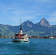 Boat on lake Vierwaldstattersee and Mt Mythen