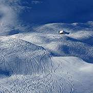 Ski and snowboard tracks and little hut