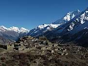 Ruined village and Annapurna Two mountains