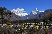 Prayer flags and snow capped mountains Lhotse and Ama Dablam