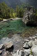 Rock in the green lake Val di Mello