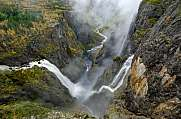 The Vøringsfossen waterfall and a few smaller ones flow down into a valley
