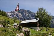 cottage and Swiss flag Derborence