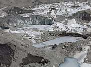 Frozen lakes and moraines on the Ngozumba Glacier