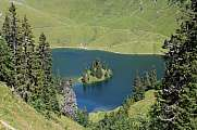 Lake Hinterstockensee with small island and trees