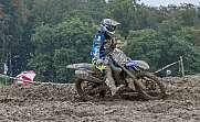 Moto Cross Rider in a muddy turn