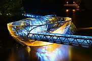 Artificial floating platform Grazer Murinsel illuminated