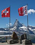 Swiss and Valais flag framing Matterhorn