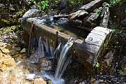 typical alpine wooden water fountain