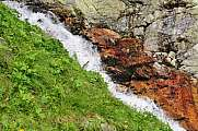 colorful stream with copper ore content