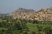 Granite mountain and rice paddy in Hampi