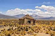 Typical Bolivian house with volcanoes