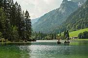 tourists fishing at lake Hintersee, bavarian alps