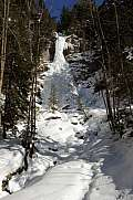 Frozen waterfall in a forest near Engelberg