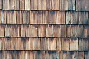 Brown wooden shingles on a wall