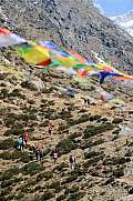 Prayer flags Nepal and group of trekkers