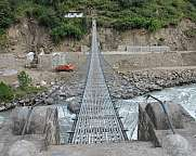 Suspension bridge over Bhote Khosi, river in Nepal