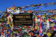 Signboard and prayer flags on the Thorang La pass