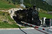 Steam train and closed railway bar in Oberwald