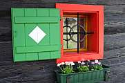 Green red window typical wooden house Styria