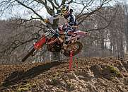 A motocross rider takes a turn acrobatically