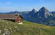 View of Mt Mythen with alpine farm house