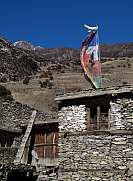 Prayer flags on a roof in Khangsar Nepal