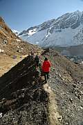 trekker walk to tent peak in abc himalaya