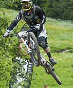 A mountain bike rider performs an acrobatic jump