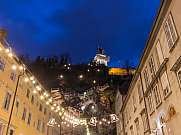 Clock Tower and houses of Graz Austria by night